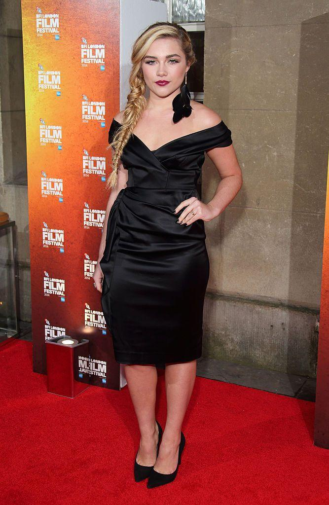 <p>Pugh wore a black cocktail dress to the 58th BFI London Film Festival Awards, October 2014.</p>