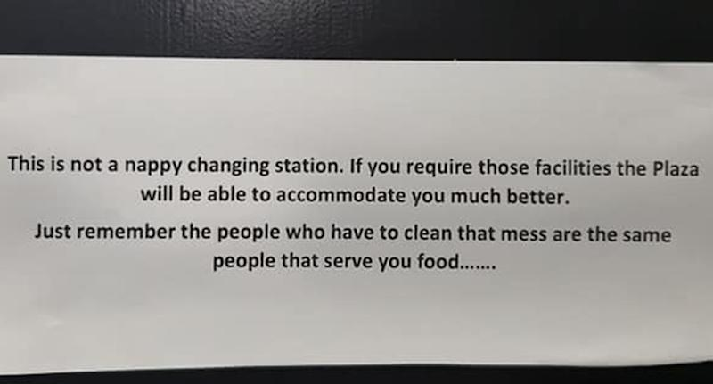 The notice posted advising customers to not change nappies in the Barely restaurant cafe.
