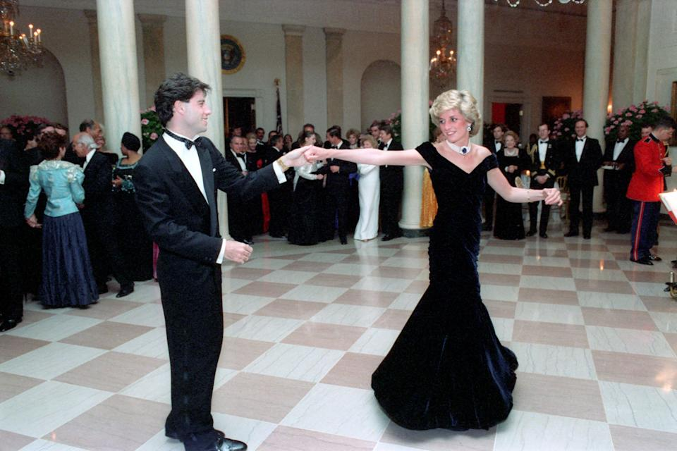 In this photo provided by the Ronald Reagan Presidential Library, Princess Diana dances with John Travolta in the Cross Hall of the White House in Washington, D.C. at a Dinner for Prince Charles and Princess Diana of the United Kingdom on November 9, 1985. (Photo by Pete Souza/Ronald Reagan Library/CNP) *** Please Use Credit from Credit Field ***