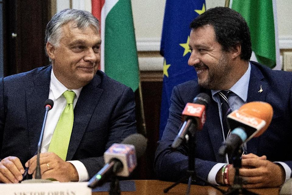 Italy's Interior Minister Matteo Salvini (R) and Hungarian Prime Minister Viktor Orban join togeether in an anti-migrant camp ahead of next year's European parliament elections (AFP Photo/MARCO BERTORELLO)
