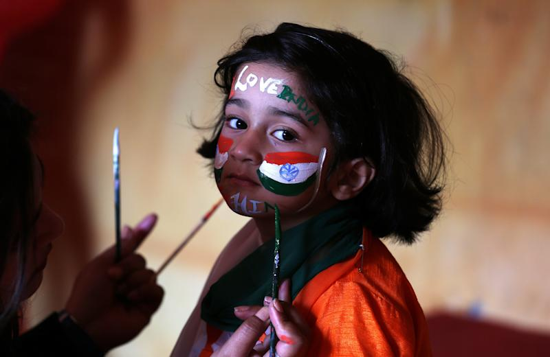A school girl gets her face painted in the colors of India's national flag before taking part in the country's Republic Day celebrations in Jammu onJan. 25, 2018. (Mukesh Gupta / Reuters)