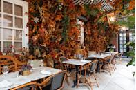 """<p>The changing makeovers of Dalloway Terrace have become synonymous with new seasons and for autumn 2020 the chic Bloomsbury spot has been transformed into an enchanted woodland. With the help of McQueens Flowers, the terrace is filled with copper and gold bark covered in leaves and foliage, illuminated by fairylights. Don't worry about the volatile British weather either – retractable walls and rook, plus outdoor heaters and blankets will ensure you stay warm. As for the cocktails, the offering is suitably autumnal, starring the TIKI Walker, created with an indulgent mix of caramel cream and cinnamon tincture.</p><p><a class=""""link rapid-noclick-resp"""" href=""""https://dallowayterrace.com/"""" rel=""""nofollow noopener"""" target=""""_blank"""" data-ylk=""""slk:MAKE A RESERVATION"""">MAKE A RESERVATION</a></p>"""
