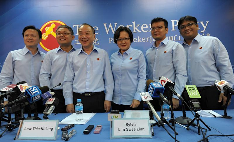Members of Singapore's Workers' Party (L to R) Dylan Eng Foo Eng, Koh Choong Yong, party secretary-general Low Thia Kiang, chairperson Sylvia Lim Swee Lian, Daniel Goh Peh Siong and Redzwan Hafidz Abdul Razak pose for the media at a press conference to introduce the party's candidates for the upcoming general election in Singapore on August 26, 2015. Officials announced on August 25 that Singapore would hold a snap general election on September 11, as Prime Minister Lee Hsien Loong seeks a new mandate from voters worried over immigration and the high cost of living. AFP PHOTO / MOHD FYROL (Photo credit should read MOHD FYROL/AFP via Getty Images)