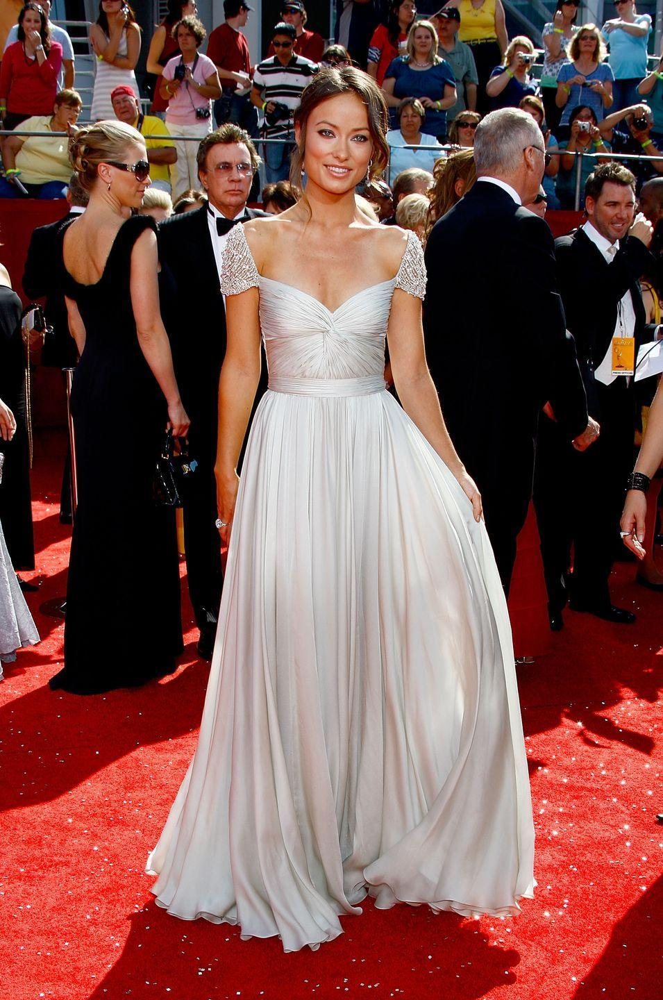 <p>The star looked stunning in a Reem Acra beaded, cap sleeve, pleated, silver chiffon, floor-length dress (and breathe!) for the A-list occasion. </p>