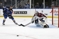 Colorado Avalanche goaltender Philipp Grubauer (31) defends the goal as Colorado Avalanche's Valeri Nichushkin (13) watches during the second period in Game 3 of an NHL hockey Stanley Cup first-round playoff series Friday, May 21, 2021, in St. Louis. (AP Photo/Scott Kane)