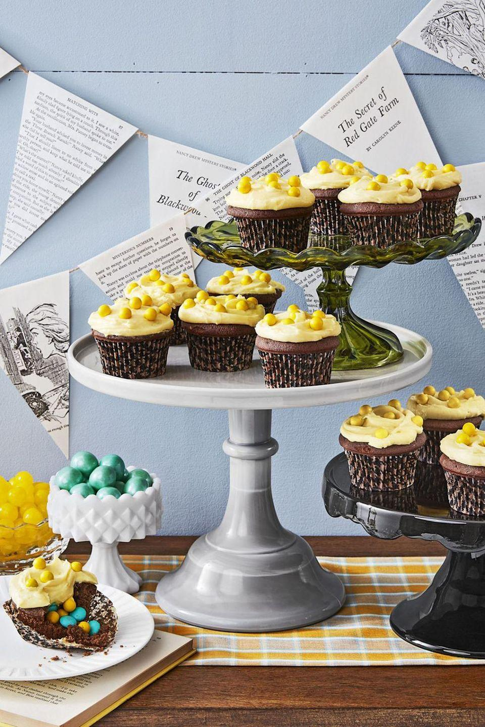 """<p>Hidden candies inside these chocolatey cupcakes make for a deliciously sweet surprise. </p><p><strong><a href=""""https://www.countryliving.com/food-drinks/recipes/a44615/devils-food-cupcakes-recipe/"""" rel=""""nofollow noopener"""" target=""""_blank"""" data-ylk=""""slk:Get the recipe"""" class=""""link rapid-noclick-resp"""">Get the recipe</a>.</strong></p><p><a class=""""link rapid-noclick-resp"""" href=""""https://www.amazon.com/YestBuy-Maypole-Wedding-Acrylic-Cupcake/dp/B011ARKU3S?tag=syn-yahoo-20&ascsubtag=%5Bartid%7C10050.g.1366%5Bsrc%7Cyahoo-us"""" rel=""""nofollow noopener"""" target=""""_blank"""" data-ylk=""""slk:SHOP CUPCAKE STANDS"""">SHOP CUPCAKE STANDS</a><br></p>"""