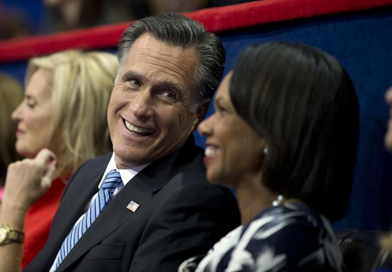 Republican presidential candidate, former Massachusetts Gov. Mitt Romney, left, talks with former Secretary of State Condoleezza Rice at the Republican National Convention on Tuesday, Aug. 28, 2012 in Tampa, Fla.  (AP Photo/Evan Vucci)