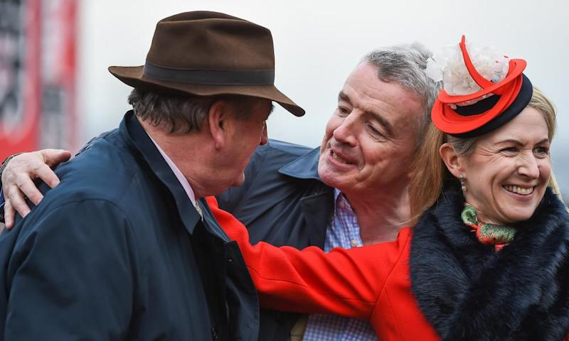 Trainer Noel Meade, left, and owners Michael and Anita O'Leary after their victory with Road To Respect at Cheltenham on Thursday.