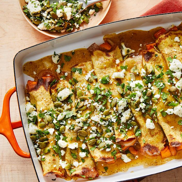 """<p>These quick sweet potato and bean enchiladas are diabetes-friendly thanks to egg wraps that are lower in carbs than traditional tortillas. The vegetarian filling is both sweet and savory, while the topping adds texture and freshness. <a href=""""https://www.eatingwell.com/recipe/7905753/25-minute-sweet-potato-bean-enchiladas/"""" rel=""""nofollow noopener"""" target=""""_blank"""" data-ylk=""""slk:View Recipe"""" class=""""link rapid-noclick-resp"""">View Recipe</a></p>"""