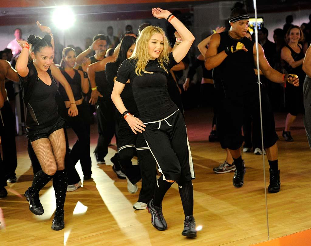 """Madonna opened her very first gym, Hard Candy Fitness, in Mexico City Monday. In honor of the opening, the Queen of Pop taught a special dance class for some lucky new members of the exclusive club. The long-time fitness fanatic plans to open more gyms in Argentina, Brazil, and Russia in the coming months. Kevin Mazur/<a href=""""http://www.wireimage.com"""" target=""""new"""">WireImage.com</a> - November 29, 2010"""