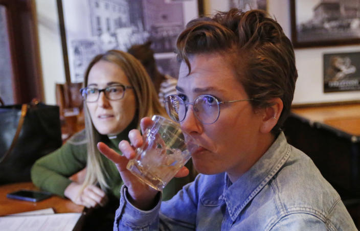 "In this Dec. 20, 2018, photo, Maude Romney, 29, right, drinks at the Beer Hive Pub, in Salt Lake City. The United States' lowest DUI threshold takes effect this weekend in Utah. Stopping for a whiskey after work with her sister at the upscale pub Beerhive, Maude Romney, 29, said she'll likely only go to places she can walk to from her home downtown. ""I'm paranoid about it already,"" she said. (AP Photo/Rick Bowmer)"