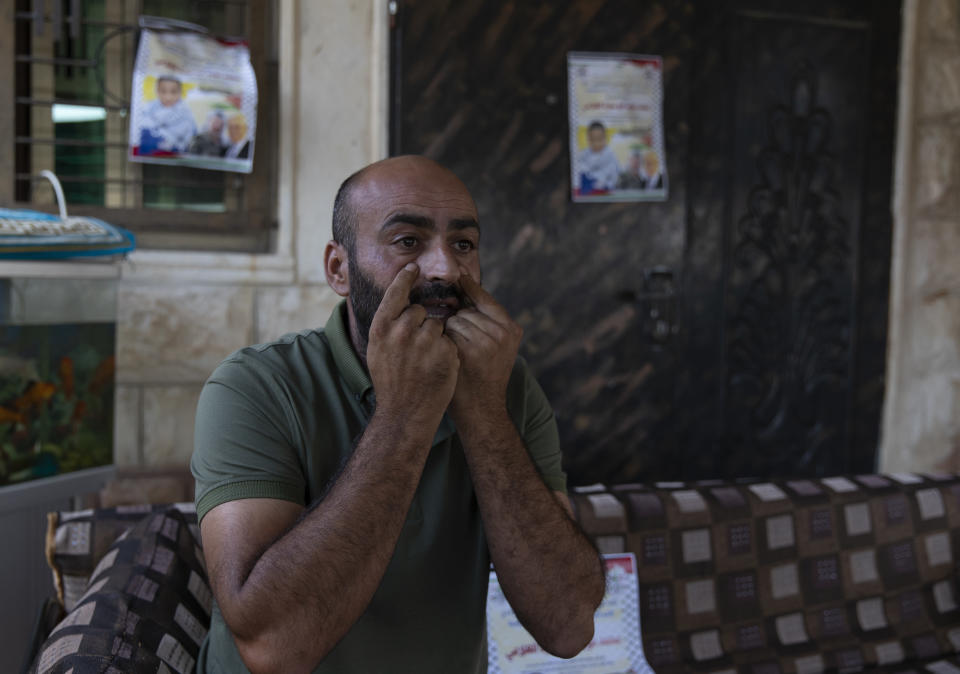 Palestinian Moayyad al-Alami, father of slain Mohammed al-Alami, 12, talks to reporters at the family house, in the West Bank village of Beit Ummar, near Hebron, Wednesday, Aug. 4, 2021. (AP Photo/Nasser Nasser)