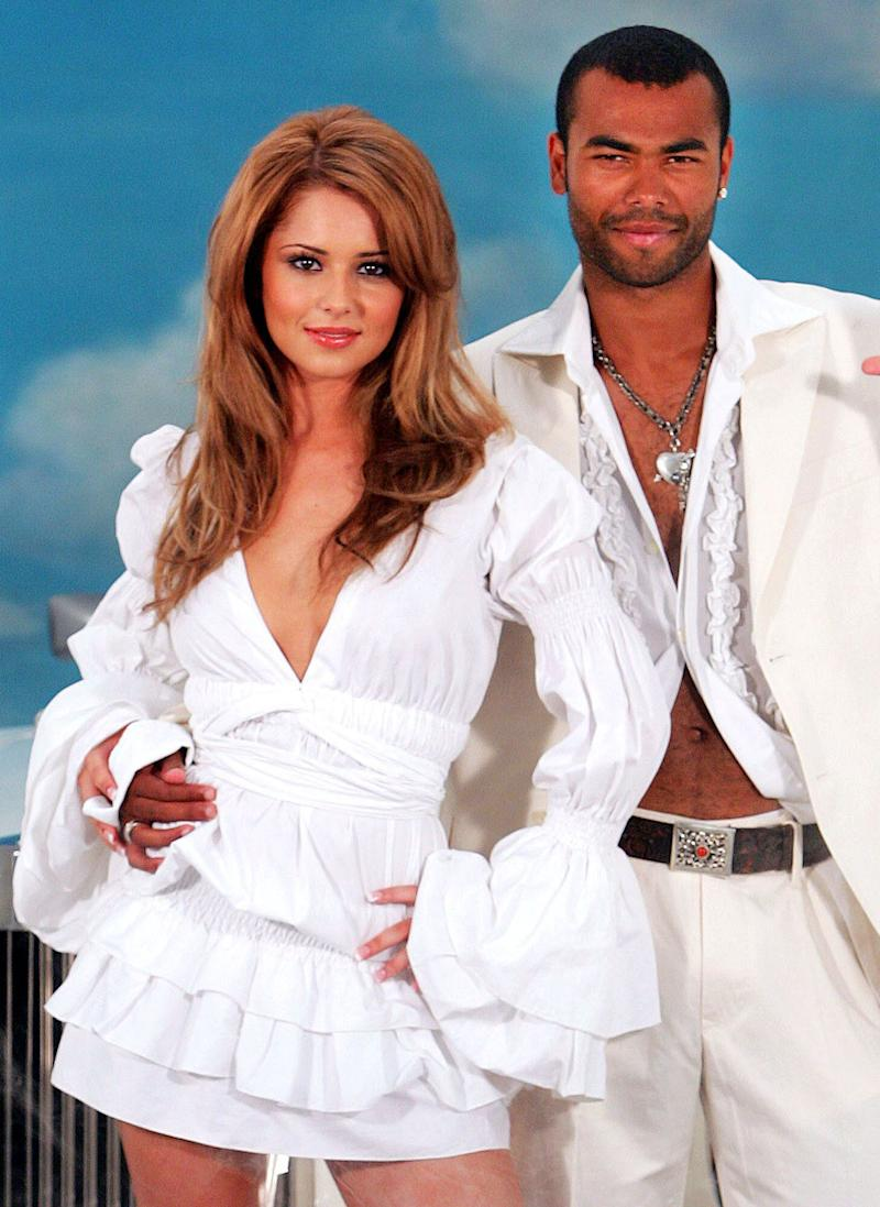 Ashley Cole and his pop star wife Cheryl Tweedy pos in all white outfits for a promotion for a lottery company in London