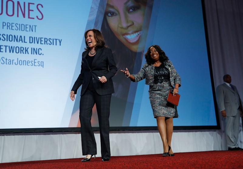 Sen. Kamala Harris, left, D-Calif., walks on stage with Star Jones at the Black Enterprise Women of Power Summit, Friday, March 1, 2019, in Las Vegas. (AP Photo/John Locher)