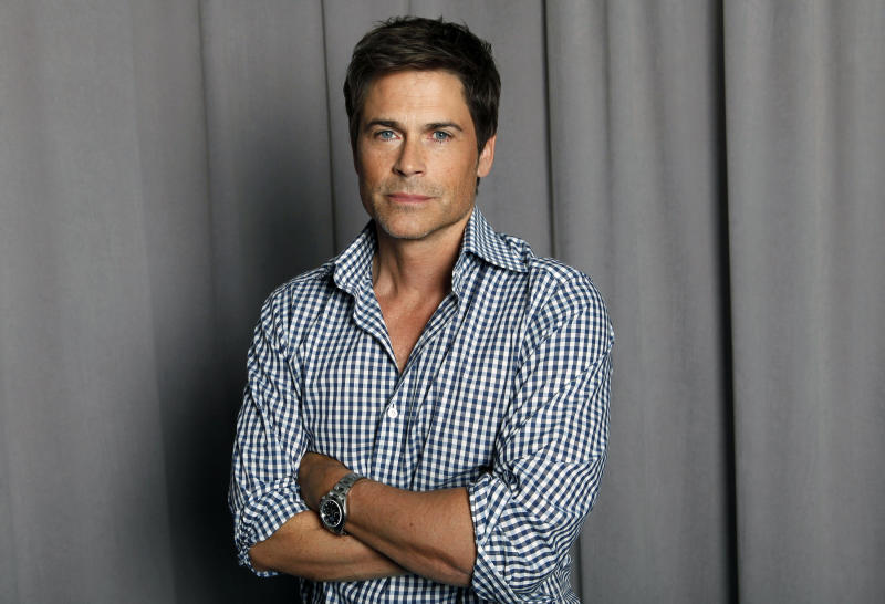 """FILE - This April 25, 2012 file photo shows actor Rob Lowe posing for a portrait in New York. Lowe will will portray President John F. Kennedy in a National Geographic film about the former president's 1963 assassination. The National Geographic Channel said Tuesday, May 28, 2013, that filming for """"Killing Kennedy"""" would begin next month in Richmond, Va. The film is expected to air around the 50th anniversary of the shooting later this year and is based on the book by Bill O'Reilly. (AP Photo/Amy Sussman, file)"""