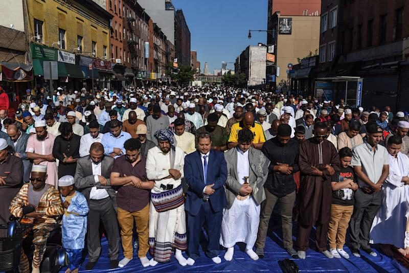 People pray outside a mosque to mark the end of the Muslim holy month of Ramadan in Brooklyn, New York, on June 4, 2019. (Photo: Stephanie Keith via Getty Images)