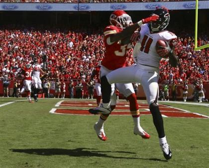 Julio Jones comes down with one of his two scores against the Chiefs. (AP)