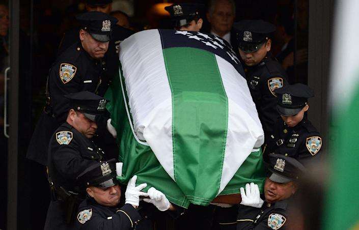 NYPD officers carry the casket of their fellow officer Wenjian Liu during his funeral in New York's borough of Brooklyn on January 4, 2015 (AFP Photo/Jewel Samad)