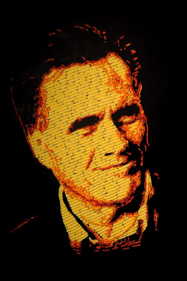 IMAGE DISTRIBUTED FOR CHEETOS - Mitt Romney is immortalized in a 3 feet by 4 feet portrait made entirely of more than 2,000 Cheetos cheese snacks by Colorado Springs, Colo. artist, Jason Baalman Tuesday, Oct. 2, 2012. Today, the Cheetos brand unveiled a new electoral polling model with the unveiling of 3 feet by 4 feet one-of-a-kind Cheetos portraits of the Democratic and Republican presidential nominees – President Barack Obama and former Gov. Mitt Romney. Debuting on Facebook today at 11 a.m. CT, fans are encouraged to vote for their candidate's portrait – made entirely of more than 2,000 individual Cheetos cheese snacks – for a chance to win the actual portrait. (Photo by Jack Dempsey/Invision for Cheetos/AP Images)