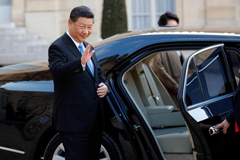 Chinese President Xi Jinping enters his car after his visit at the Elysee presidential palace in Paris, Tuesday, March 26, 2019. The leaders of China and France are trying to ramp up efforts against climate change and are calling for a global rethink of investments to make them more planet-friendly. (AP Photo/Francois Mori)