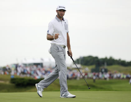 Dustin Johnson reacts after making an eagle putt on the 16th hole. (AP)