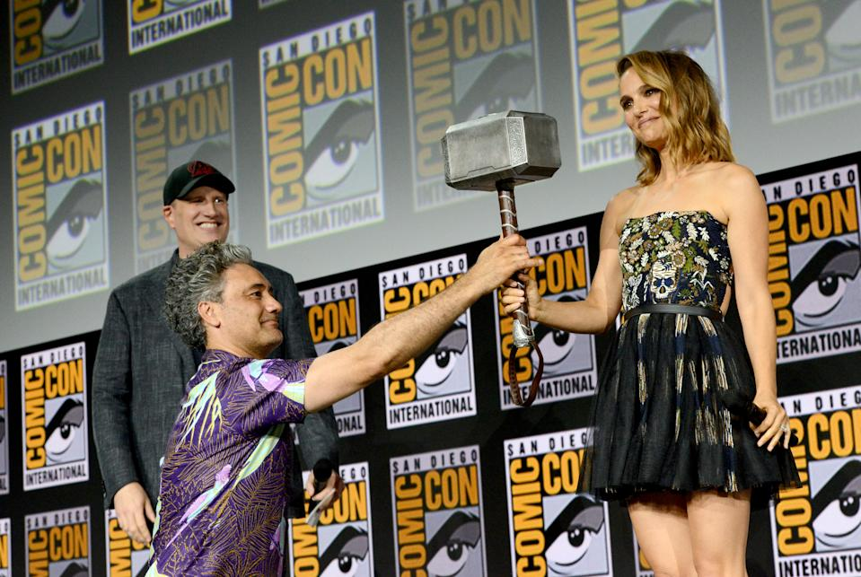 SAN DIEGO, CALIFORNIA - JULY 20: (L-R) Kevin Feige, Taika Waititi and Natalie Portman speak at the Marvel Studios Panel during 2019 Comic-Con International at San Diego Convention Center on July 20, 2019 in San Diego, California. (Photo by Albert L. Ortega/Getty Images)