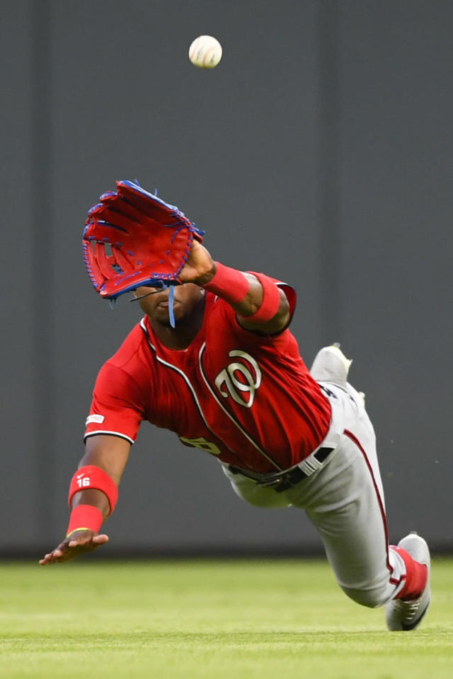 Washington Nationals center fielder Victor Robles makes a diving catch on a ball off the bat of Atlanta Braves' Dansby Swanson during the fifth inning of a baseball game Sunday, July 21, 2019, in Atlanta. (AP Photo/John Amis)