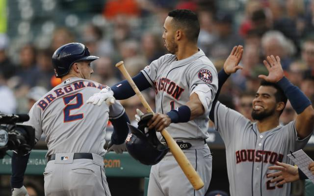 Houston Astros' Alex Bregman (2) is greeted by teammates Carlos Correa (1) and Robinson Chirinos (28) after hitting a solo home run during the first inning of the team's baseball game against the Detroit Tigers, Wednesday, May 15, 2019, in Detroit. (AP Photo/Carlos Osorio)
