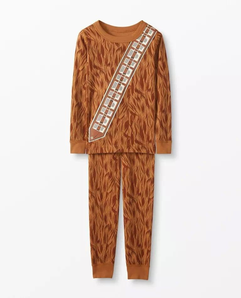 <p>The matching <span>Star Wars Glow-in-the-Dark Long John Pajamas in Organic Cotton, Chewbacca</span> ($50) pays homage to their favorite character.</p>