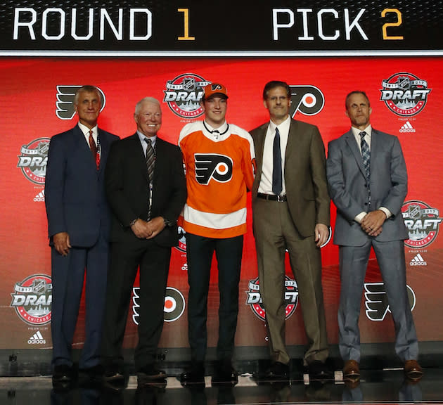 "Nolan Patrick, center, wears a <a class=""link rapid-noclick-resp"" href=""/nhl/teams/phi/"" data-ylk=""slk:Philadelphia Flyers"">Philadelphia Flyers</a> jersey after being selected by the team in the first round of the NHL hockey draft, Friday, June 23, 2017, in Chicago. (AP Photo/Nam Y. Huh)"