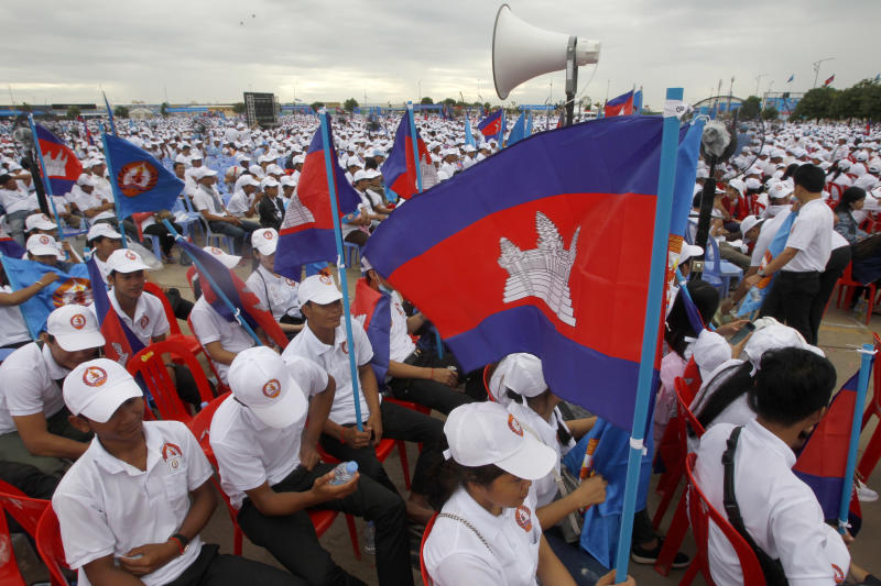 FILE - In this July 7, 2018, file photo, supporters wait for the start of a campaign rally of Cambodian Prime Minister Hun Sen's Cambodian People's Party in Phnom Penh, Cambodia. A California-based security-research firm said Wednesday, July 11, 2018, that it found evidence that an elite Chinese government-linked hacking team has penetrated computer systems belonging to Cambodia's election commission, opposition leaders and media in the months leading up to Cambodia's July 29 election. (AP Photo/Heng Sinith, File)