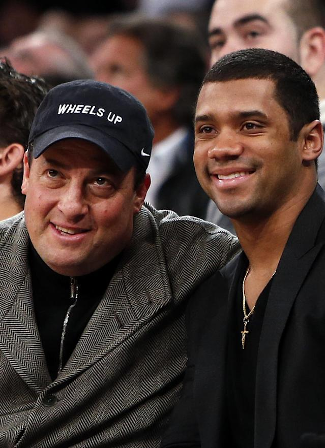 Actor Steve Schirripa, left, and Seattle Seahawks quarterback Russell Wilson pose for a photograph together as they attend an NBA basketball game between the Dallas Mavericks and the New York Knicks, Monday, Feb. 24, 2014, in New York. Dallas won 110-108. (AP Photo/Jason DeCrow)