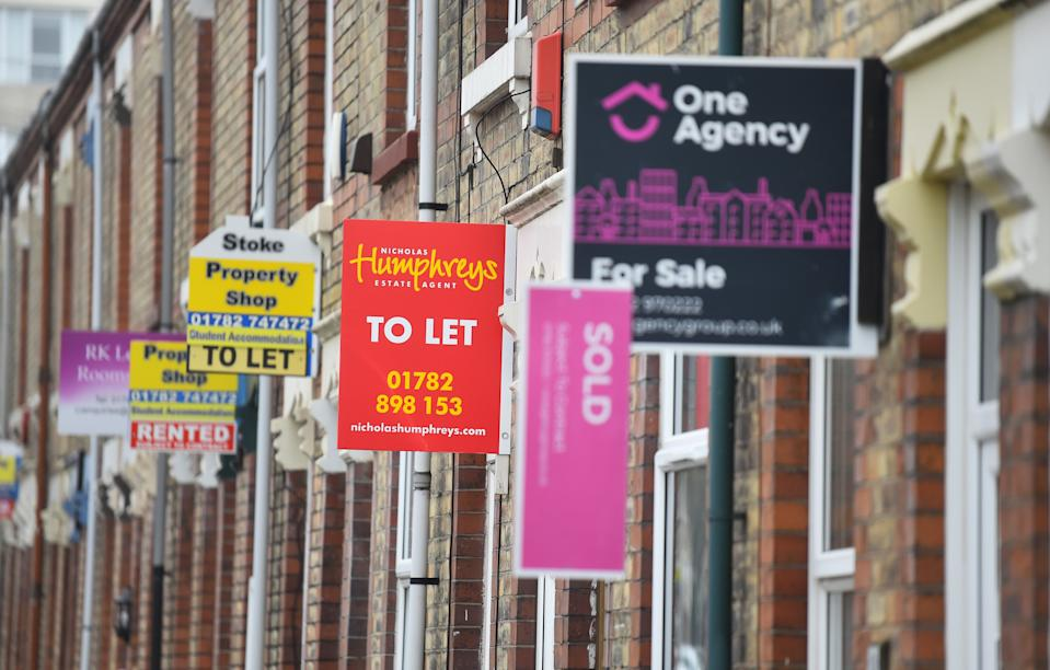 STOKE-ON-TRENT, ENGLAND - MARCH 03: Placards from various estates agents advertising properties To Let , For Sale and Sold on March 03, 2021 in Stoke-on-Trent, England. UK Chancellor, Rishi Sunak, announced the return of 95% mortgages to help first-time buyers. He also announced that house buyers would be exempt from paying stamp duty for a further three months with the scheme ending on 31st June 2021. (Photo by Nathan Stirk/Getty Images)