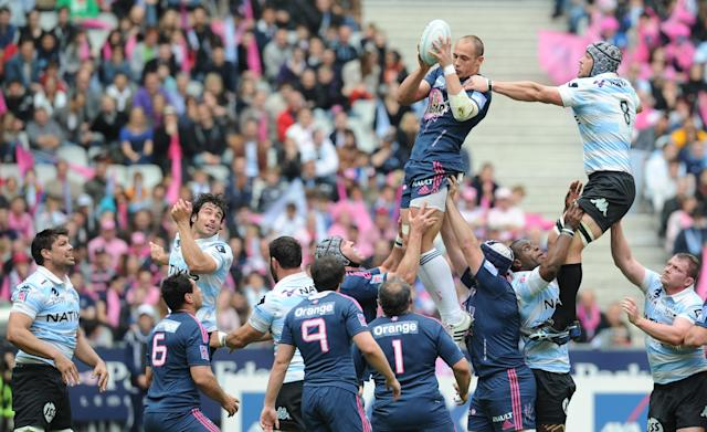 Stade Francais' flanker Antoine Burban (C) and Racing Metro's South African Number 8 and captain Jacques Cronje during the French Top 14 rugby union match Stade Francais vs. Racing Metro on May 5, 2012 at the Charlety stadium in Paris. AFP PHOTO / FRANCK FIFEFRANCK FIFE/AFP/GettyImages