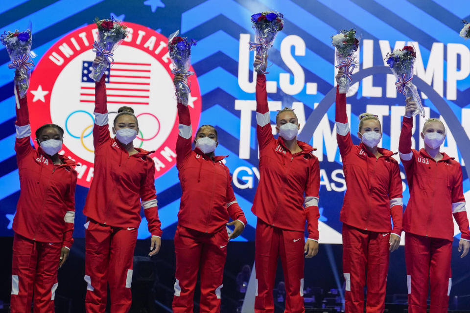 Members of the U.S. Women's Olympic Gymnastic Team, Simone Biles, Suni Lee, Jordan Chiles, and Grace McCallum plus individual members MyKayla Skinner and Jade Carey (L-R) are announced after the U.S. Olympic Gymnastics Trials Sunday, June 27, 2021, in St. Louis. (AP Photo/Jeff Roberson)