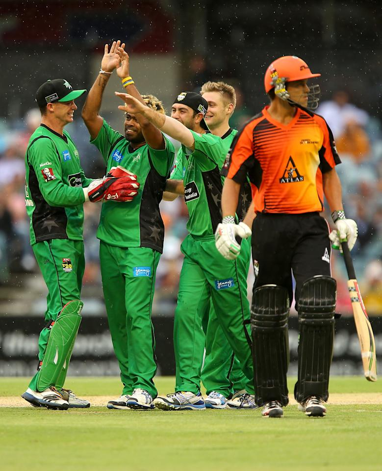PERTH, AUSTRALIA - DECEMBER 12:  Lasith Malinga of the Stars is congratulated by team mates after dismissing Nathan Coulter-Nile of the Scorchers during the Big Bash League match between the Perth Scorchers and the Melbourne Stars at WACA on December 12, 2012 in Perth, Australia.  (Photo by Paul Kane/Getty Images)