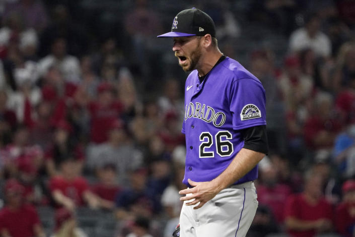 Colorado Rockies starting pitcher Austin Gomber yells as he walks back the dugout after giving up a two-run home run to Los Angeles Angels' Shohei Ohtani during the sixth inning of a baseball game Tuesday, July 27, 2021, in Anaheim, Calif. (AP Photo/Mark J. Terrill)