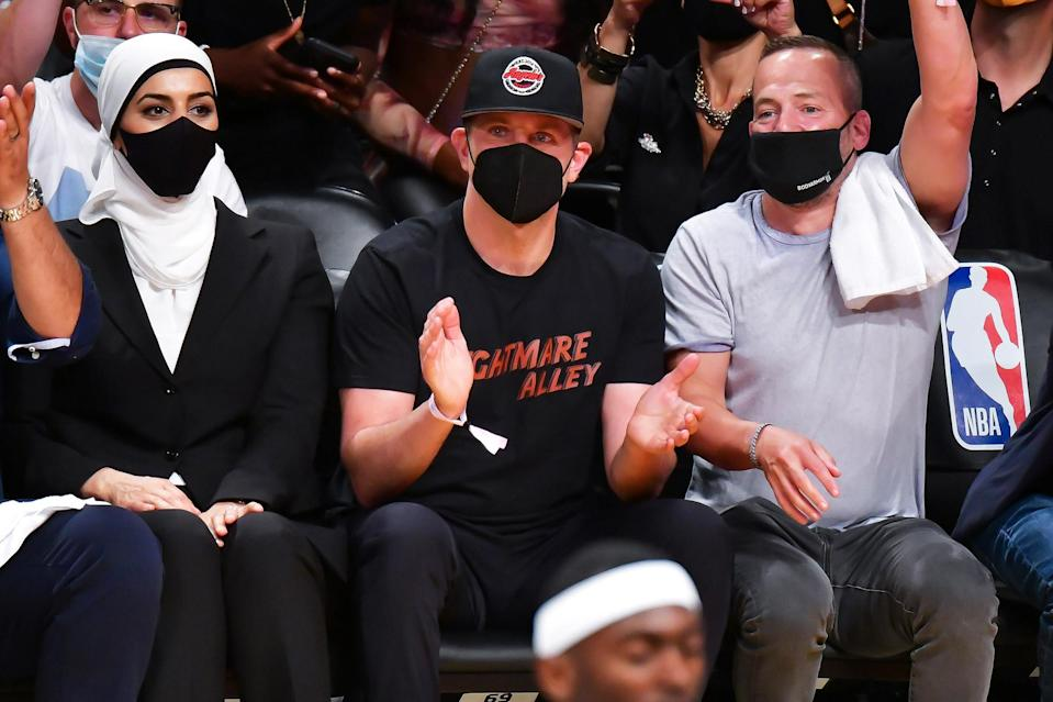 <p>Bradley Cooper claps it up courtside at the Brooklyn Nets vs. Milwaukee Bucks game at the Barclays Center in N.Y.C. on June 7.</p>