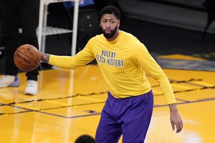 Los Angeles Lakers forward Anthony Davis warms up before an NBA basketball game.