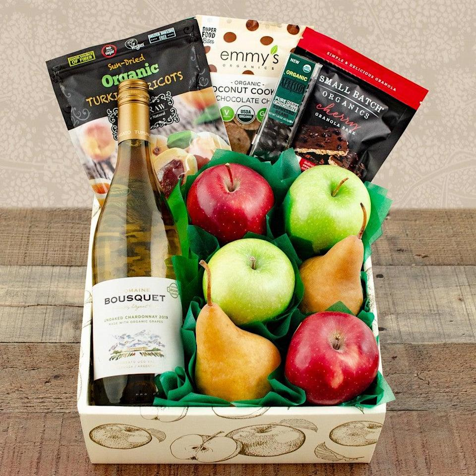 """<h2>Organic White Wine, Fruit, & Snack Gift Box</h2> <br>If your mom is into all-natural varietals, this gift box packed with everything from a bottle of organic white wine to fresh fruit and other healthy snacks will more than do the surprise-gifting trick. <br><br><em>Shop </em><strong><em><a href=""""https://www.winebasket.com/"""" rel=""""nofollow noopener"""" target=""""_blank"""" data-ylk=""""slk:Winebasket.com"""" class=""""link rapid-noclick-resp"""">Winebasket.com</a></em></strong><br><br><strong>Multiple Brands</strong> Happy & Healthy Organic White Wine, Fruit & Snax Gift Box, $, available at <a href=""""https://go.skimresources.com/?id=30283X879131&url=https%3A%2F%2Fwww.winebasket.com%2FHappy-Healthy-Organic-White-Wine-Fruit-Snax-Gift-Box_2"""" rel=""""nofollow noopener"""" target=""""_blank"""" data-ylk=""""slk:Winebasket.com"""" class=""""link rapid-noclick-resp"""">Winebasket.com</a><br><br><br>"""