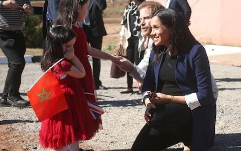 The Duke and Duchess of Sussex meet sisters Rania Minejem aged 5 and Rayhana Minejem aged 2 - Credit: PA