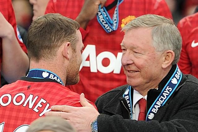 Manchester United manager Sir Alex Ferguson with Wayne Rooney before the trophy presentation