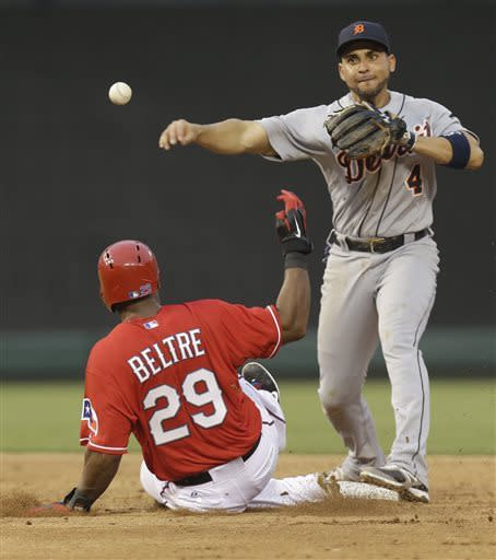 Detroit Tigers second baseman Omar Infante (4) turns a double play against Texas Rangers Adrian Beltre (29) during the second inning of the baseball game Saturday, May 18, 2013, in Arlington, Texas. Rangers Nelson Cruz was out at first base. (AP Photo/LM Otero)