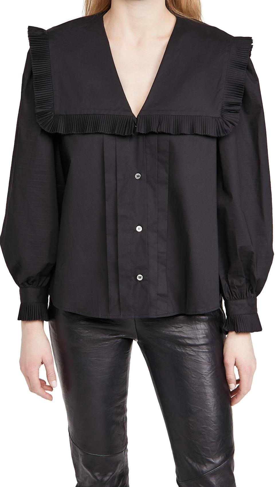 <p>If you can't part with your black clothes even in the summer, go with this <span>Sea Charlie Cotton Pleated Blouse</span> ($219, originally $365).</p>