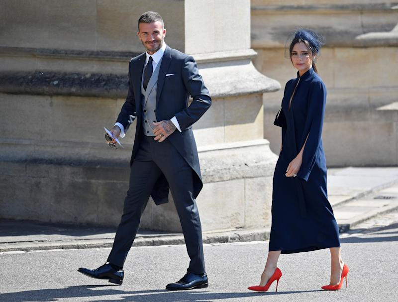 David and Victoria Beckham arrive at the royal wedding on May 19.