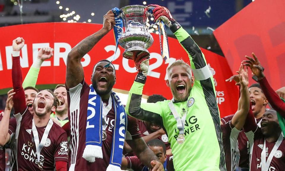 Kasper Schmeichel lifts the trophy with Wes Morgan