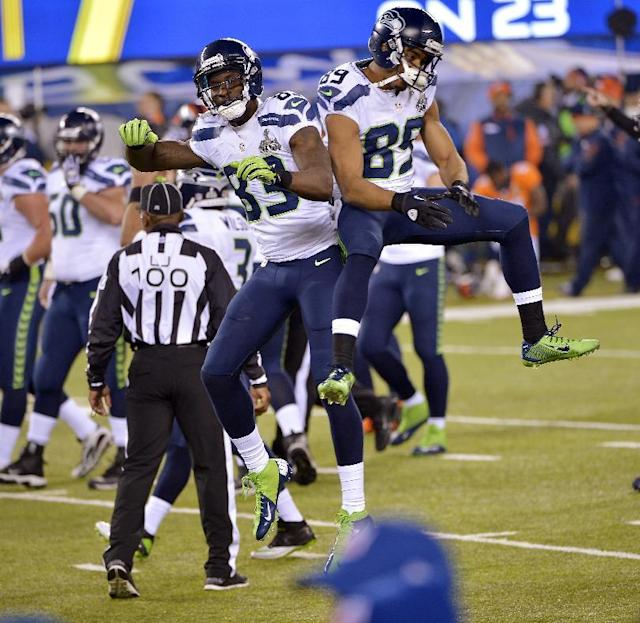 Seattle Seahawks' Ricardo Lockette (83) and Doug Baldwin celebrate during the second half of the NFL Super Bowl XLVIII football game against the Denver Broncos Sunday, Feb. 2, 2014, in East Rutherford, N.J. (AP Photo/Bill Kostroun)