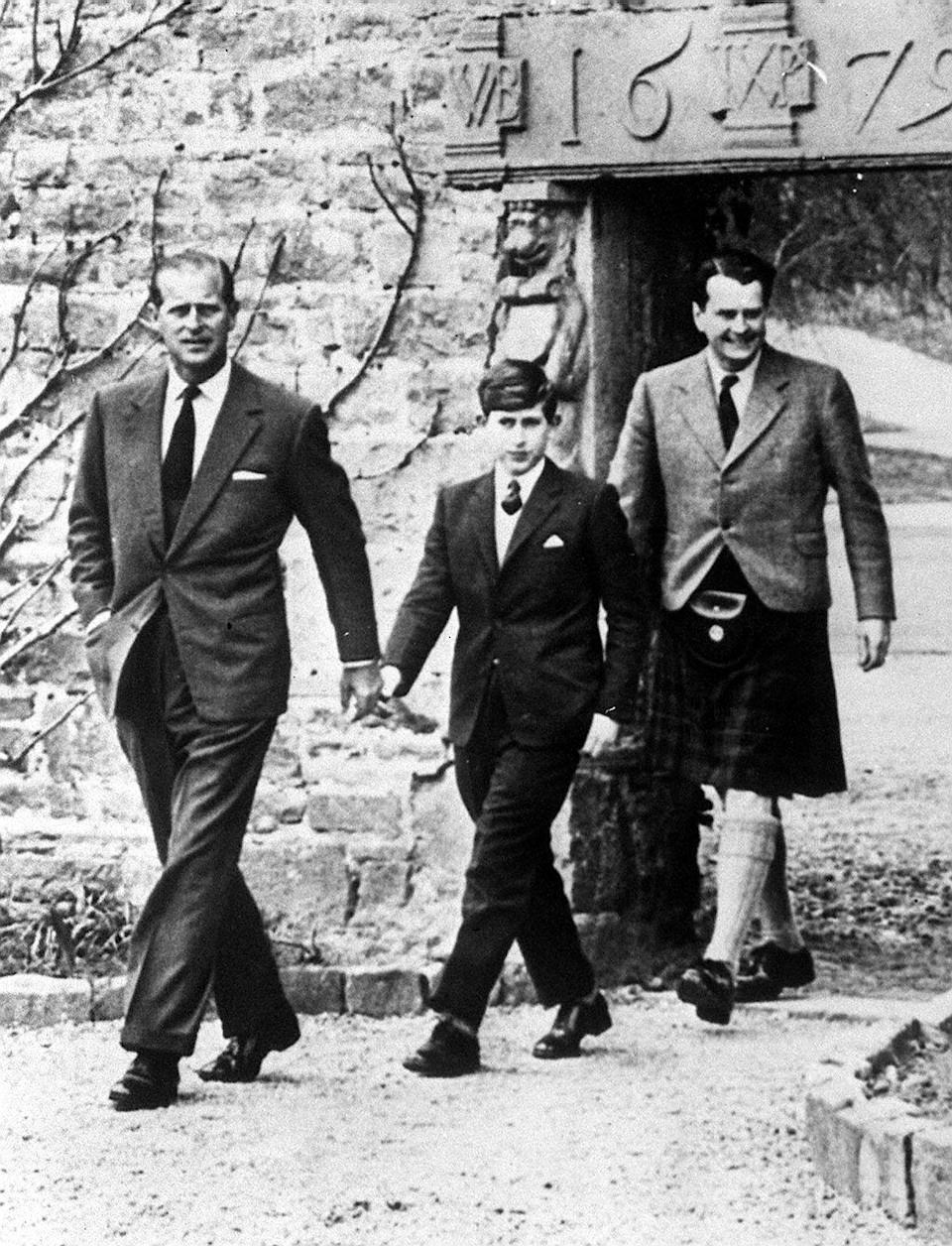 The Prince of Wales, with his father the Duke of Edinburgh (left) and Captain Iain Tennant, Chairman of the Gordonstoun Board of Governors, arriving at Gordonstoun for the Prince's first day at Pulic School.   (Photo by PA Images via Getty Images)