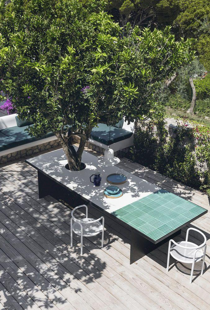 """<p>Enjoying meals in full sun is not to everybody's taste. This inventive dining table uses a beautiful, mature tree as an in-built shade, and is large enough to keep the sun-worshippers happy, too. The tiled top is highly practical and provides endless options for customisation. Bespoke tables can be sourced from <a href=""""https://www.benningtonmetalfurniture.co.uk/"""" rel=""""nofollow noopener"""" target=""""_blank"""" data-ylk=""""slk:Bennington Metal Furniture"""" class=""""link rapid-noclick-resp"""">Bennington Metal Furniture</a>.</p>"""