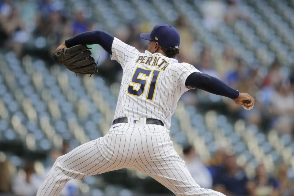 Milwaukee Brewers' Freddy Peralta pitches during the first inning of the team's baseball game against the Arizona Diamondbacks on Friday, June 4, 2021, in Milwaukee. (AP Photo/Aaron Gash)